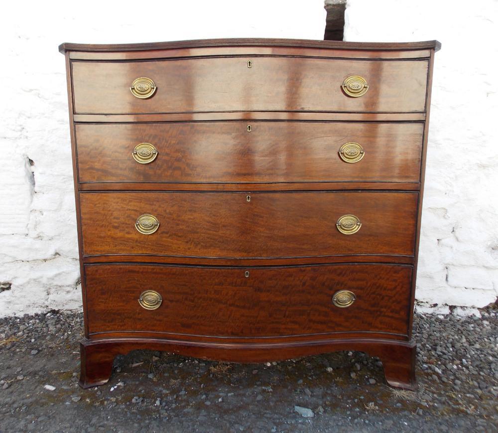 Georgian serpentine mahogany plum pudding chest of drawers.