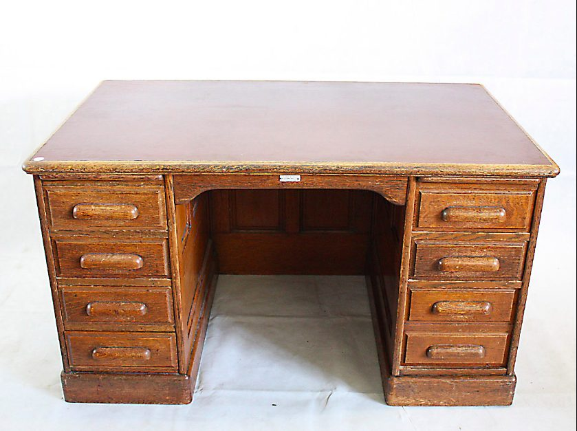 Early 20th Century oak pedestal partners desk, by Thomas Turner,