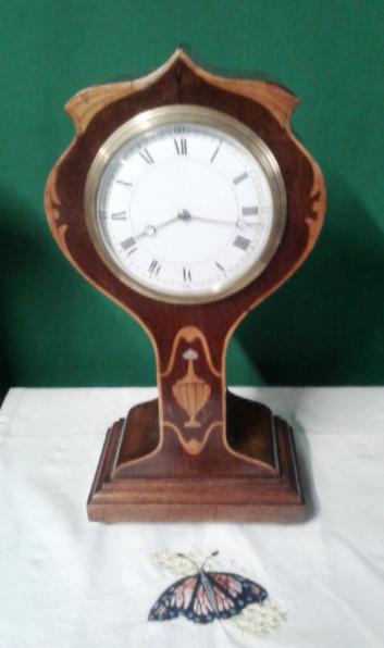 Edwardian inlaid mahogany tulip mantle clock