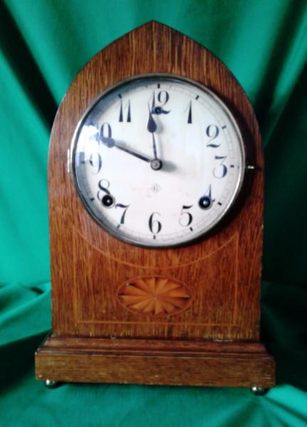 Edwardian oak cased lancet clock