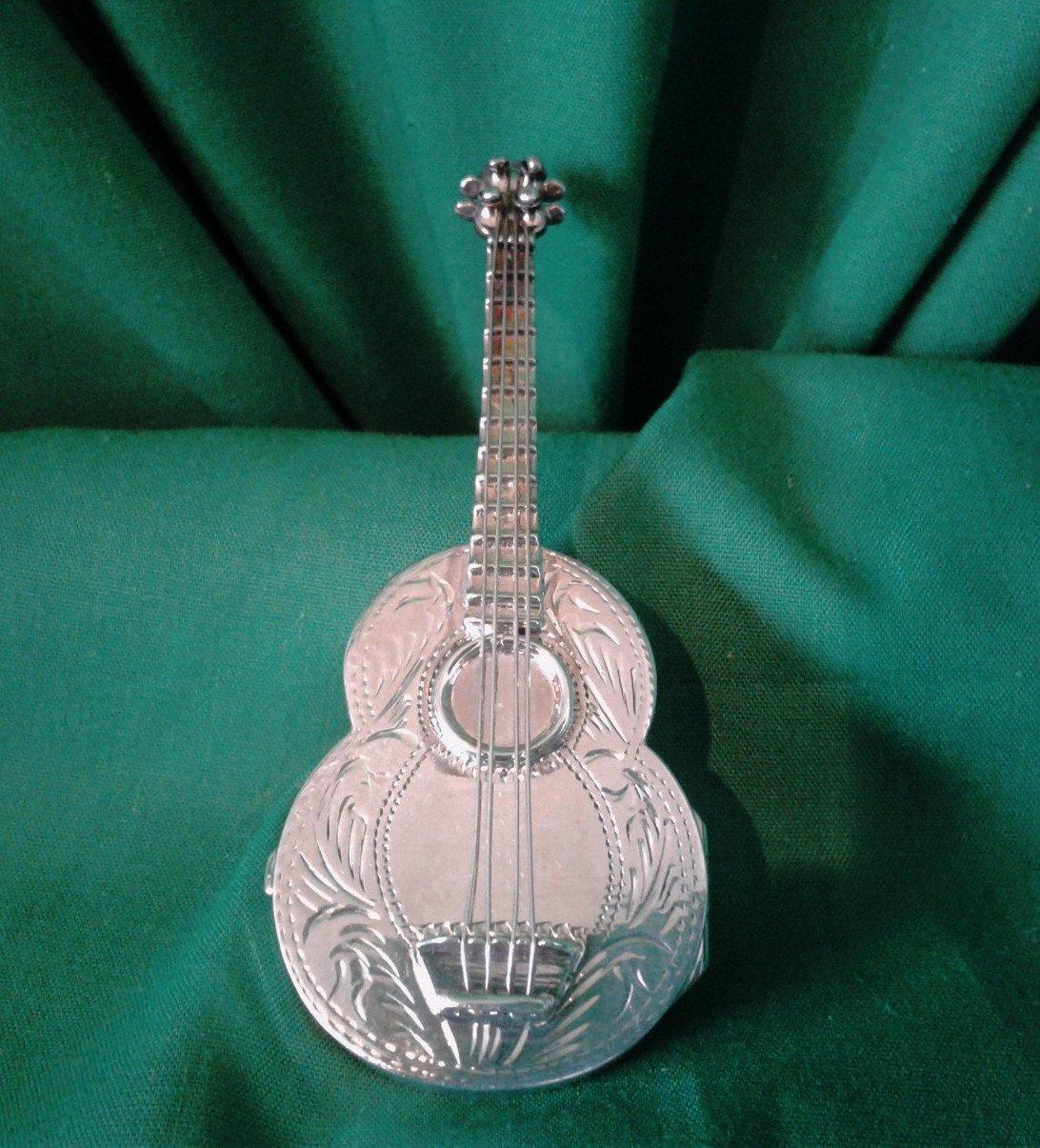 Silver acoustic guitar pill box
