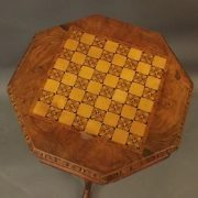 A Victorian parquetry inlaid trumpet table