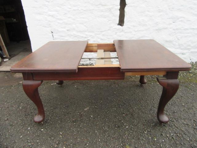 Edwardian Queen Ann mahogany dining table.
