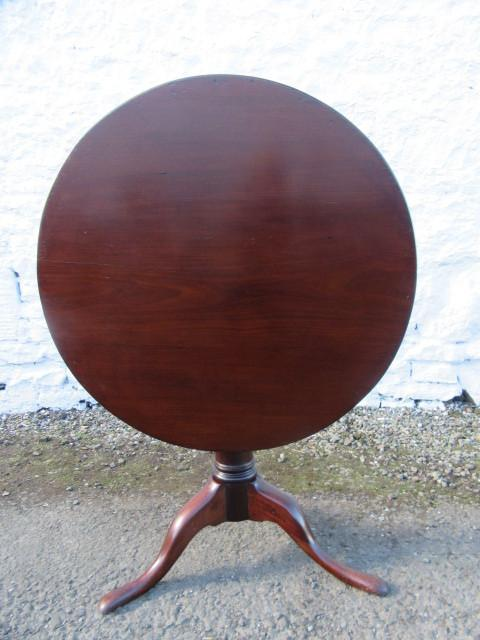 Georgian mahogany bird cage snap top table