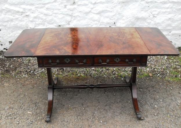 Edwardian mahogany stretcher sofa table.