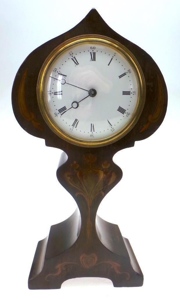 Edwardian mahogany tulip mantle clock