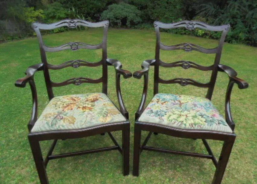 Georgian mahogany carved serpentine fronted ladder back carver chairs.